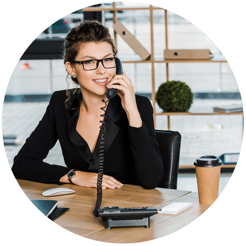 business woman talking on phone in office